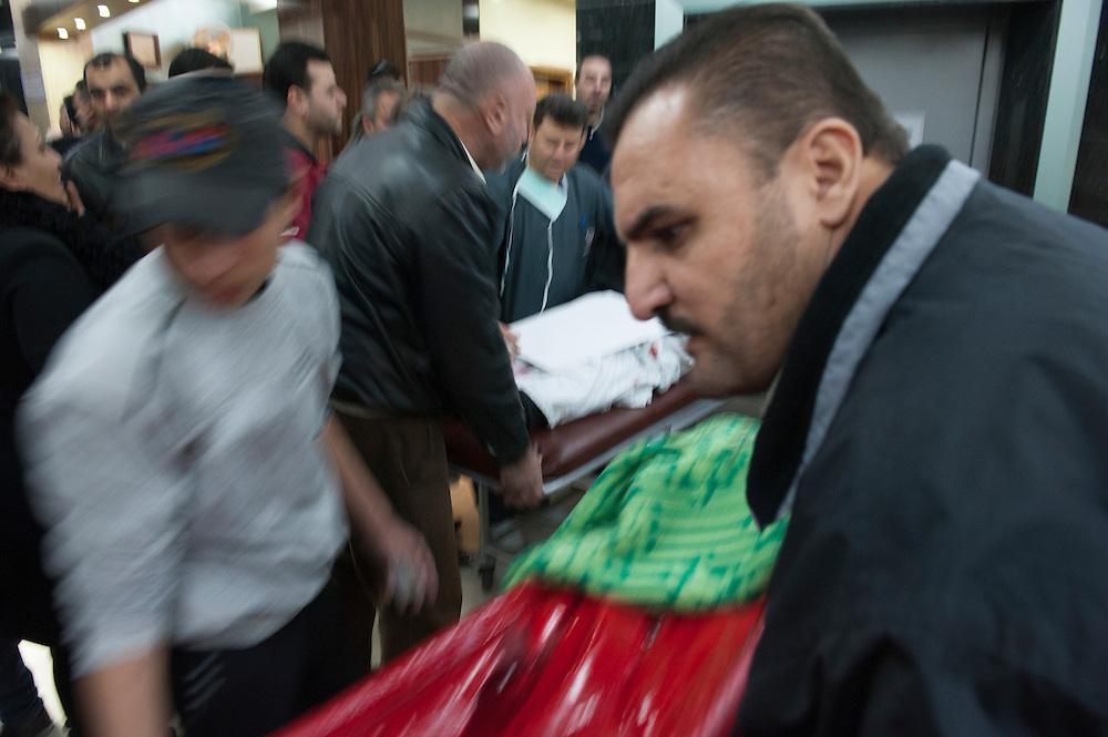 January 11, 2012, Homs, Syria. Wounded are rushed in a hospital near the Hadara district in Homs where mortar boms were fired causing the death of Gilles Jacquier and bystanders in Homs, Syria. It is not proven who performed the attack.<br /> <br /> 11 janvier 2012, Homs, Syrie. Des blessés sont précipités dans un hôpital près du quartier d'Hadara, à Homs, où l'on a tiré des mortiers qui ont causé la mort de Gilles Jacquier et de passants. Il n'est pas prouvé qui a effectué l'attaque.