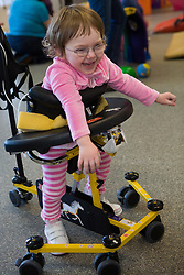 United States, Washington, Bellevue, girl in walker at Kindering Center