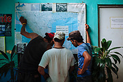 Inside of the Casa del Migrante Scalabrini, three Honduran migrants observe in a Mexico's map the route to reach the United States, in Tapachula, Mexico, February 22, 2013.