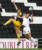 Photo: Steve Bond/Richard Lane Photography. MK Dons v Southampton. Coca-Cola Football League One. 20/03/2010. Rickie Lambert, (L) andMathias Doumbe (R) in the air