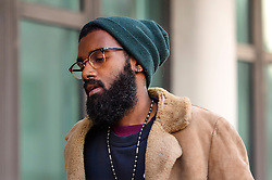 © Licensed to London News Pictures. 17/01/2017. London, UK. JOSHUA VIRASAMI, arrives at Willesden Magistrates Court in west London where he is one of nine people charged with wilfully obstructing the highway at Heathrow Airport. A group of protesters supporting the Black Lives Matter group blocked the M4 spur road to Heathrow Airport in August last year. Photo credit: Ben Cawthra/LNP