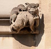 Gargoyle below Magdalen Great Tower, part of Magdalen College, Oxford University, England.