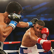 ORLANDO, FL - OCTOBER 04:  Jantony Ortiz (R) throws a punch at Gilberto Mendoza during a professional super flyweight boxing match at the Bahía Shriners Auditorium & Events Center on October 4, 2014 in Orlando, Florida. Ortiz would go on to win the fight. (Photo by Alex Menendez/Getty Images) *** Local Caption *** Jantony Ortiz; Gilberto Mendoza