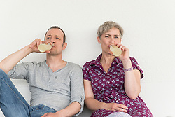 Mature couple drinking drink from bottle