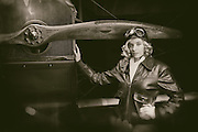 "A young model posing as a late twenties aviatrix with a Curtiss JN-4D ""Jenny"" at WAAAM."