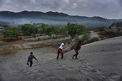 September 1, 2017 - Yogyakarta, Indonesia - Indonesian muslims gather to perform Eid Al-Adha prayer at Sand dunes Parangkusumo Beach on September 1, 2017 in Yogyakarta, Indonesia. Muslims worldwide celebrate Eid Al-Adha, to commemorate the Prophet Ibrahim's readiness to sacrifice his son as a sign of his obedience to God, during which they sacrifice permissible animals, generally goats, sheep, and cows. (Credit Image: © Nugroho Hadi Santoso/NurPhoto via ZUMA Press)