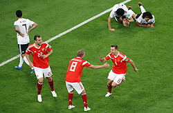 Russia's Denis Cheryshev (right) celebrates scoring his side's second goal of the game during the FIFA World Cup 2018, Group A match at Saint Petersburg Stadium.