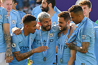 BRIGHTON, ENGLAND - MAY 12:  Sergio Aguero (10) of Manchester City celebrates with his team mates on the podium as they wait for the trophy to be lifted during the Premier League match between Brighton & Hove Albion and Manchester City at American Express Community Stadium on May 12, 2019 in Brighton, United Kingdom. (MB Media)