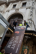At the end of its run at Wyndham's Theatre, promo hoardings for The Height Of The Storm starring Jonathan Pryce and Eileen Atkins are brought down and replaced by comedian Bill Bailey's Christmas performances of 'Larks in Transit', at Wyndham's Theatre, on 3rd December 2018, in London, UK