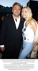 MISS HEATHER BIRD and MR ROBERT TCHENGUIZ former close friend of model Caprice, at a party in London on 22nd May 2002.PAI 84