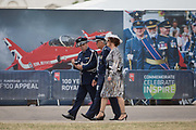 On the 100th anniversary of the Royal Air Force RAF and after a march andflypast of 100 aircraft formations representing Britains air defence history which flew over central London, foreign service oficers walk past an RAF recruiting hoarding, on 10th July 2018, in London, England.