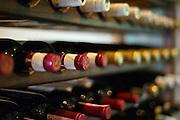 Wine bottles in a wine rack.