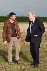 """© Licensed to London News Pictures. 23/02/2012. Wallington, Surrey. L-R: Seb Coe and Boris Johnson. The Mayor of London, Boris Johnson and LOCOG Chairman Sebastian Coe today, 23 February 2012, showed off the benefits of urban food growing as they launched """"The Big Dig"""" volunteer gardening weekend (16-17 March). This is all in support of Capital Growth, a scheme to create 2,012 community food growing spaces by the end of 2012.  Photo credit: Bettina Strenske/LNP"""