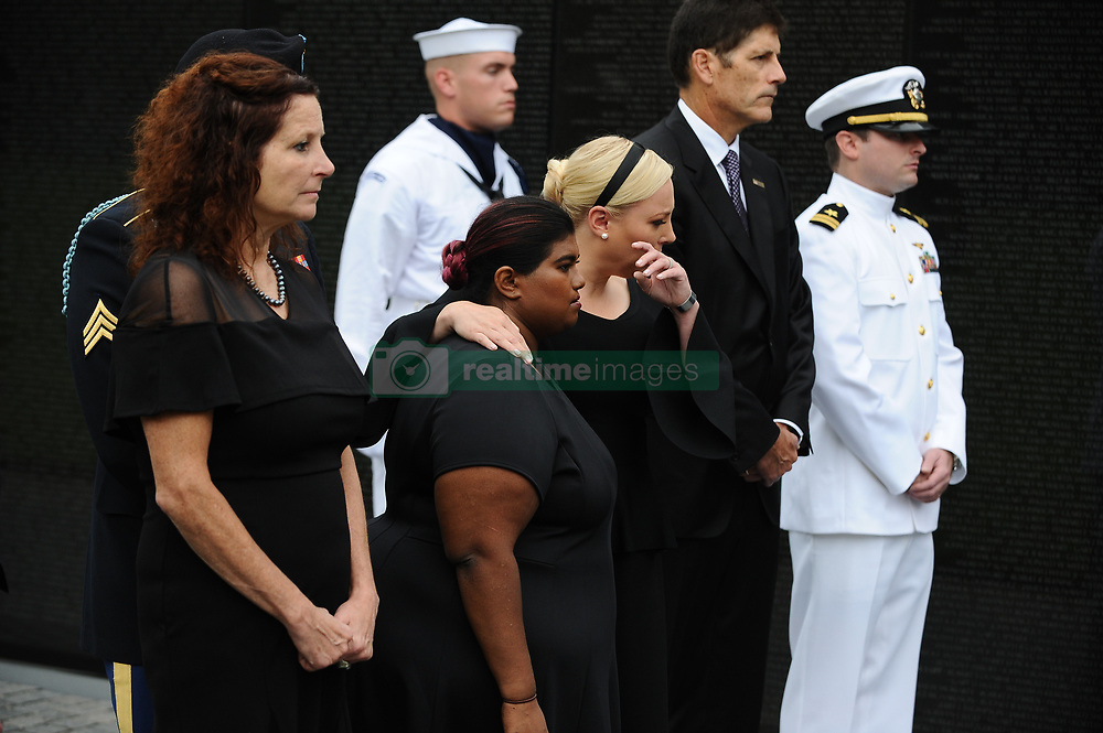WASHINGTON, D.C. - SEP 1, 2018: People wait for Cindy McCain, the wife of Sen. John McCain, R-Ariz., to visit at the Vietnam Veterans Memorial in Washington on Saturday, Sep. 1, 2018. Credit: Ray Whitehouse / Pool via CNP. 01 Sep 2018 Pictured: Bridget McCain, and Meghan McCain hug while U.S. Secretary of Defense James Mattis, General John Kelly, White House Chief of Staff and Cindy McCain, wife of late Senator John McCain, lay a ceremonial wreath honoring all whose lives were lost during the Vietnam War at the Vietnam Veterans Memorial in Washington, U.S., September 1, 2018. Credit: Mary F. Calvert / Pool via CNP. Photo credit: Ray Whitehouse - Pool via CNP / MEGA TheMegaAgency.com +1 888 505 6342