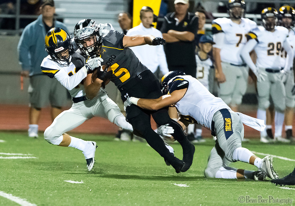 Del Oro Golden Eagle's Dalton Gee (5), is tackled after a gain during the third quarter as the Del Oro Golden Eagles varsity football team host the Oak Ridge Trojans, Friday Oct 21, 2016.<br /> photo by Brian Baer