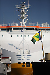 """A flag from the country of St. Vincent flies in front of an Italian ship at the port in Limassol, Cyprus on Feb. 22, 2008. Cyprus is the crossroads of international ship management and  where all the agencies are recruiting and hiring the cheapest workers worldwide. Cyprus is also one of the """"Flag-of-Convenience"""" States like Panama and Liberia."""