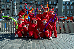 Pictured:  Performers from the Vermillion High Thespians promote their show ANTics<br /> <br /> The Edinburgh Festival Fringe attracts all sorts of performers and audiences while the city continues to operate