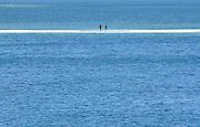 Portuguese Summer. General view shows tourists on the sandy beach of Figueirinha beach at Arrábida.