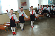 Songs about invincible might instilled by the doctrine of the Great Leader. Kangan Primary school in Sonkyo District, Pyongyang..2nd and 3rd grade classes visited..(C)Jeremy Horner.15 Mar 2004