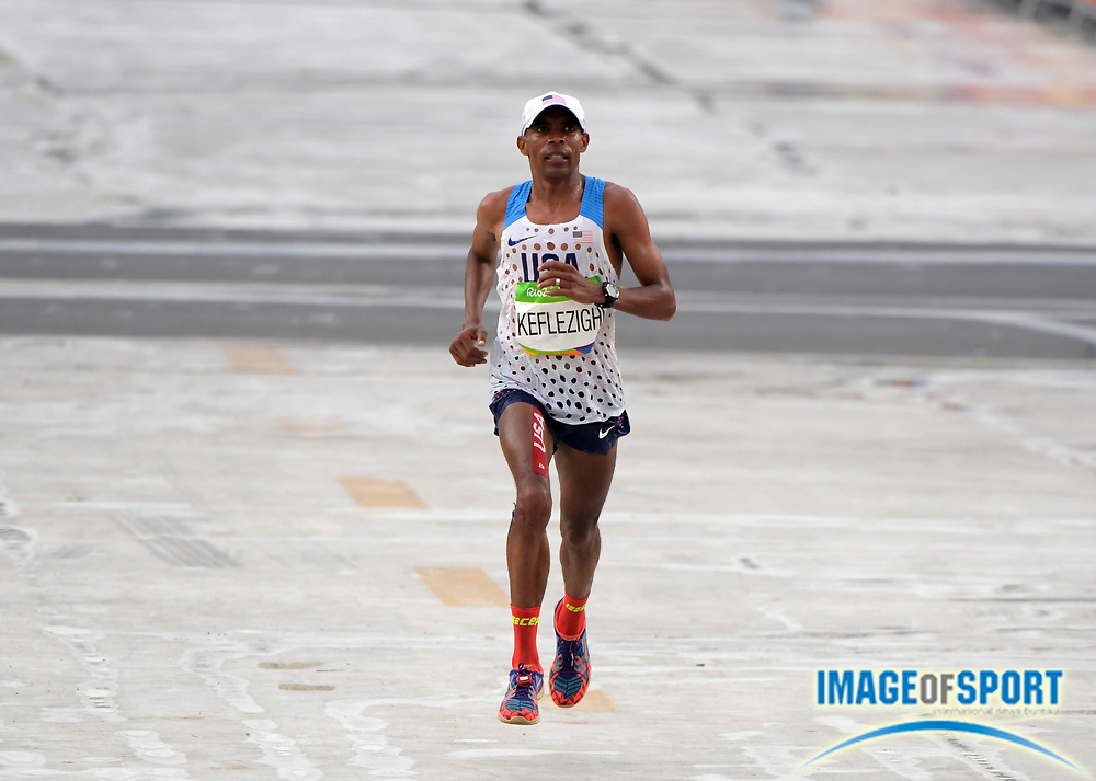 Aug 21, 2016; Rio de Janeiro, Brazil; Meb Keflezighi (USA) places 33rd in the marathon in 2:16:46 during the Rio 2016 Summer Olympic Games at Sambodromo.