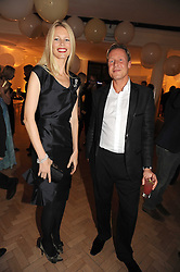 CLAUDIA SCHIFFER and GEOFFROY MEDINGER general manager Van Cleef & Arpels UK   at Vogue's Fantastic Fashion Fantasy Party in association with Van Cleef & Arpels to celebrate Vogue's Secret Address Book held at One Marylebone Road, London NW1 on 3rd November 2008.