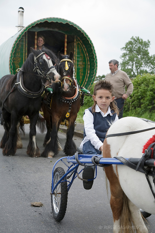 Yoing boy with a pony and sulky cart outside Appleby