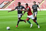 Moses Odubajo of Sheffield Wednesday  and Zak Jules of Walsall battle for the ball during the EFL Cup match between Walsall and Sheffield Wednesday at the Banks's Stadium, Walsall, England on 5 September 2020.
