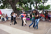 Tango dancers in the street, in the daytime at San Telmo market, San Telmo, Buenos Aires, Argentina. .