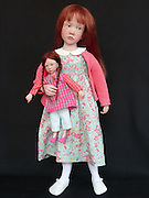 Living dolls: French artist sculpts scarily realistic collectables complete with freckles and uncanny facial expressions<br /> <br /> With her sparkling blue eyes, long red locks and pretty bow she looks just like a normal little girl.<br /> It's hard to believe that she won't start running around causing mischief or playing with the toy that she clutches.<br /> But the little red-head is actually a scarily realistic doll created by French artist Laurence Ruet.<br /> The doll is one of a collection of intricately crafted unique creations which normally fetch between 450 and 1,350 Euros each.<br /> Hardly a crying, walking living doll and a far cry from the Cabbage Patch Kid dolls of old, the creations are not advertised as toys but as collectors items.<br /> Each child takes Laurence around two weeks to craft and cannot be replicated - they are not made using a mould.<br /> Made from a malleable polymer resin, the dolls are cooked rather like ceramics with limbs and faces fashioned from acrylic.<br /> Laurence painstakingly shapes each child's facial expression - the hardest part to make she says - and seems to have a penchant for freckles.<br /> <br /> The eyes are made of glass and the hair either from mohair or real hair.<br /> As well as the dolls themselves, she also pays great attention to crafting unique cloths and shoes - with each child dressed in classical clothing.<br /> <br /> She said: 'My aim is to give emotion. I am very sensitive to expressions like delicacy, timidity, surprise and tenderness.'<br /> The dolls range from newborn to nursery school age with 'mini-bebes' starting at eight inches long and the biggest creations standing at an almost lifelike 22 inches tall.<br /> Laurence of Dijon in France, who only makes a handful of the dolls each year, was a portrait painter until she discovered her love for creating the lifelike children 12 years ago.<br /> She now says that it is her favourite art medium.<br /> © Laurence Ruet/Exclusivepix