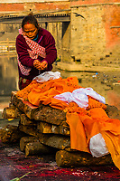 A corpse is prepared for cremation on the funeral pyre. Pashupatinath Temple, a Hindu temple along the Bagmati River in Kathmandu, Nepal. The Bagmati is equally as sacred to Nepalese as the Ganges is to Indians. Hindus are brought to be cremated here. to be cremated here.
