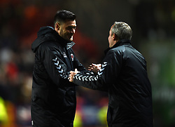 Charlton Athletic assistant manager Johnnie Jackson and manager Lee Bowyer celebrate victory a full time