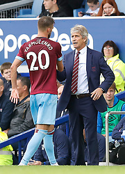West Ham United's Andriy Yarmolenko (left) shake hands with manager Manuel Pellegrini after being substituted off