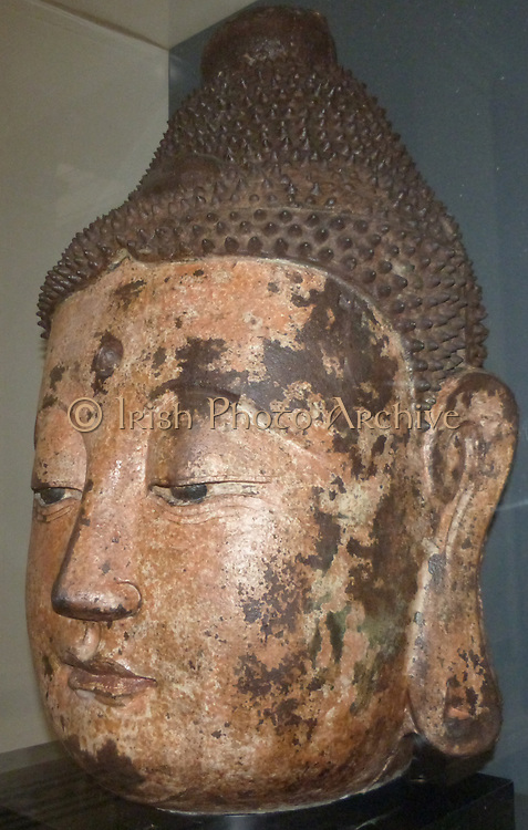 Buddha Head - Bronze, (circa 1368-1644)  Ming dynasty.  This head is all that remains of a statue, presumably from a temple.  Hollow inside, it is made of bronze cast in section moulds.  The bronze surface was covered with a layer of kaolin then painted with layers of linen-fibre paper.