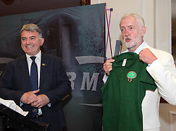 June 25, 2017 - Exeter, Devon, UK - Exeter, Devon, UK. JEREMY CORBYN, the leader of the Labour Party, is presented with a commemorative sash and a t-shirt by RMT General Secretary MICK CASH. Corbyn spoke at the start of the RMT union's annual general meeting in Exeter. Picture credit : Simon Chapman/LNP (Credit Image: © Simon Chapman/London News Pictures via ZUMA Wire)
