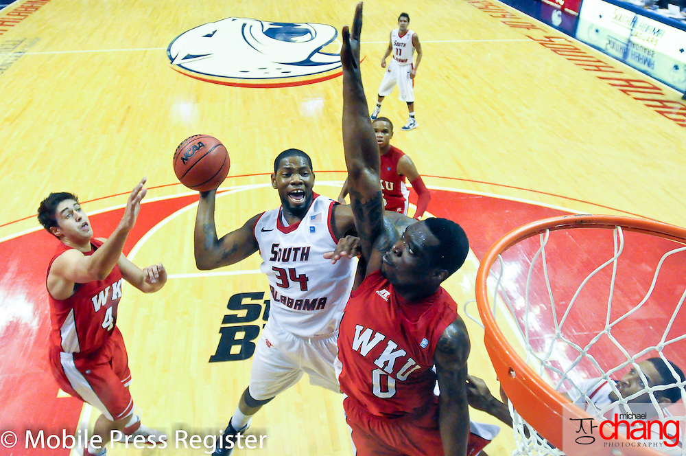 South Alabama's Antione Lundy (#34) attempts a shot by a Western Kentucky player at the Mitchell Center Saturday, Feb 18, 2012, in Mobile, Ala. (Press-Register, Michael Chang) SPORTS