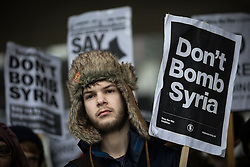 """© Licensed to London News Pictures . 05/12/2015 . Manchester , UK . Approximately one hundred anti-war protesters march through central Manchester against Parliament's decision to vote in favour of bombing against """" ISIS """" , in Syria . Photo credit : Joel Goodman/LNP"""