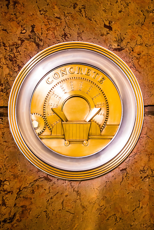 A brass, Art Deco medallion, or roundel, on the Empire State Bulding's marble-lined lobby -- one of 11 such roundels, each honoring a different technolgy or craft essential to the construction of the great building. This one celebrates concrete.