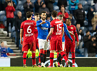 Football - 2019 / 2020 UEFA Europa League - Round of Sixteen, First Leg: Rangers vs. Bayer 04 Leverkusen<br /> <br /> Connor Goldson of Rangers and Julian Baumgartlinger of Bayer Leverkusen at full time, at Ibrox Stadium, Glasgow.<br /> <br /> COLORSPORT/BRUCE WHITE