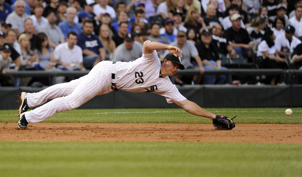 CHICAGO - JUNE 20:  Mark Teahen #23 of the Chicago White Sox dives but cannot catch the ball hit by Geovany Soto #18 of the Chicago Cubs on June 20, 2011 at U.S. Cellular Field in Chicago, Illinois.  The Cubs defeated the White Sox 6-3.  (Photo by Ron Vesely)  Subject:  Mark Teahen;Geovany Soto