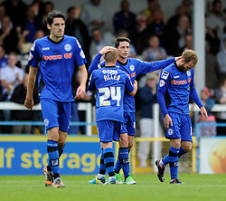 Rochdale's Ian Henderson celebrates with his team mates after scoring. - Photo mandatory by-line: Dougie Allward/JMP - Mobile: 07966 386802 23/08/2014 - SPORT - FOOTBALL - Manchester - Spotland Stadium - Rochdale AFC v Bristol City - Sky Bet League One