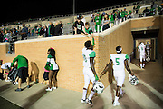 Marshall Thundering Herd players walk to the locker room after losing to the North Texas Mean Green at Apogee Stadium in Denton, Texas on October 8, 2016. (Cooper Neill for The Herald-Dispatch)