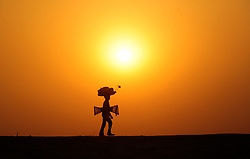 March 24, 2017 - Allahabad, Uttar Pradesh, India - A vendor return to his home after day long work during sunset at Sangam in Allahabad, India. (Credit Image: © Prabhat Kumar Verma via ZUMA Wire)