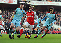 Football - 2016 / 2017 Premier League - Arsenal vs. Burnley<br /> <br /> Alexis Sanchez of Arsenal and  Dean Marney and Matthew Lowton of Burnley at The Emirates.<br /> <br /> COLORSPORT/ANDREW COWIE