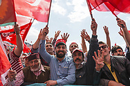 Crowds do the Rabiaa hand gesture and wave flags in support of Turkish president Recep Tayyip Erdogan at an AK Party rally in Izmir, Turkey.
