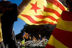 September 11, 2017 - Barcelona, Catalonia, Spain - In Barcelona, coinciding with Catalan  national day or Diada, a man waves a estelada flag (sign of Catalan independence) as  hundreds of thousands fill the streets demanding the independence of Catalonia. Catalan government aims to celebrate a referendum on independence next first october. (Credit Image: © Jordi Boixareu via ZUMA Wire)