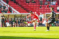 Alex Mowatt of Barnsley (27) shoots during the EFL Sky Bet League 1 match between Barnsley and Shrewsbury Town at Oakwell, Barnsley, England on 19 April 2019.