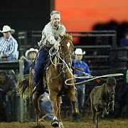 Larry Bailey of Plant City, Florida ropes a calf during the 129th performance of the PRCA Silver Spurs Rodeo at the Silver Spurs Arena   on Friday, June 1, 2012 in Kissimmee, Florida. (AP Photo/Alex Menendez) Silver Spurs rodeo action in Kissimee, Florida. PRCA rodeo event in Florida. The 129th annual running of the cowboy event.