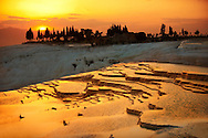 Photo & Image  of Pamukkale Travetine Terrace, Turkey, at sunset. Images of the white Calcium carbonate rock formations. Buy as stock photos or as photo art prints. 3 Pamukkale travetine terrace water cascades, composed of white Calcium carbonate rock formations, Pamukkale, Anatolia, Turkey .<br /> <br /> If you prefer to buy from our ALAMY PHOTO LIBRARY  Collection visit : https://www.alamy.com/portfolio/paul-williams-funkystock/pamukkale-hierapolis-turkey.html<br /> <br /> Visit our TURKEY PHOTO COLLECTIONS for more photos to download or buy as wall art prints https://funkystock.photoshelter.com/gallery-collection/3f-Pictures-of-Turkey-Turkey-Photos-Images-Fotos/C0000U.hJWkZxAbg