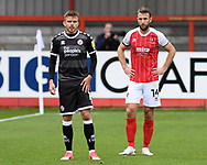 Crawley Town defender Archie Davies (15) and Cheltenham Town forward Andy Williams (14) during the EFL Sky Bet League 2 match between Cheltenham Town and Crawley Town at Jonny Rocks Stadium, Cheltenham, England on 10 October 2020.