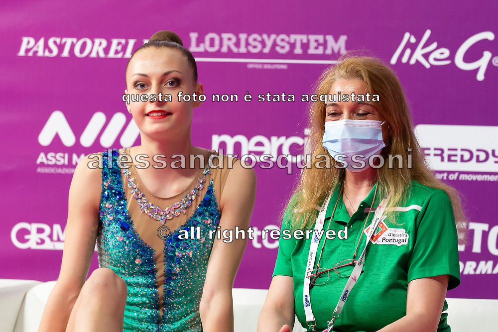 Dalia Porokhnya sitting at the Kiss and Cry of the Rhythmic Gymnastics World Cup in Pesaro.
